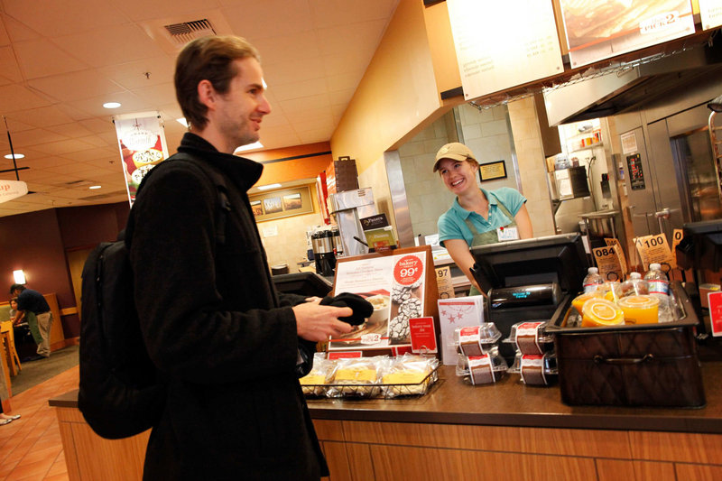 Lacey Walker, right, serves a customer at a Panera Bread Co. restaurant in Burbank, Calif., last month. The chain is part of the fast-growing market in the restaurant industry that is fancier than fast-food options but cheaper than sit-down places.