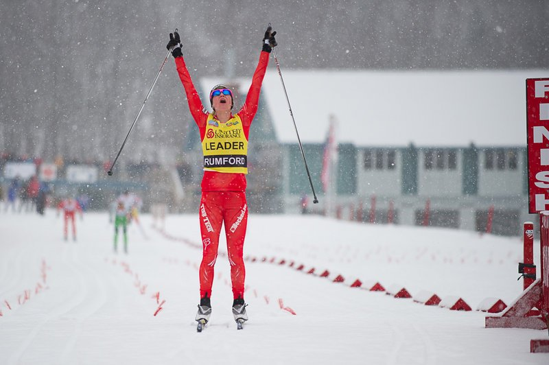 Jessie Diggins of Minnesota celebrates as she crosses the finish line to win the women's 20K classical event Friday at the U.S. Cross Country Championships in Rumford, claiming her third national title in three races this week.