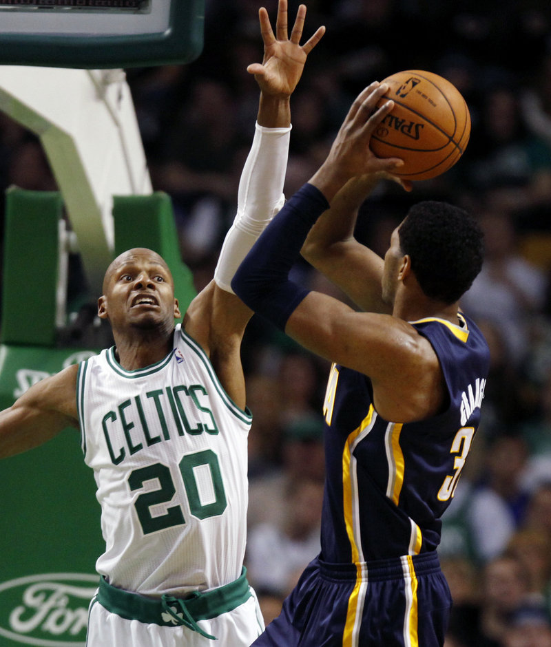 Danny Granger of the Indiana Pacers looks for room to shoot over Ray Allen of the Boston Celtics during the third period of the Pacers' 87-74 victory Friday night.