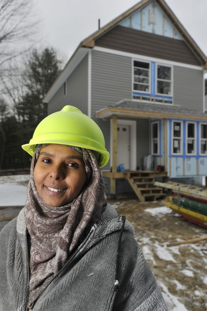 "Hana Tallan is helping with work on a home she has purchased from Habitat for Humanity of Greater Portland, one of 11 Habitat homes under construction or being planned in Freeport. ""I feel empowered,"" she said. ""Every day that I work on my house, I'm learning new things. I know what my house is made of. I brag about it to my co-workers. ... It will be a beautiful home."""