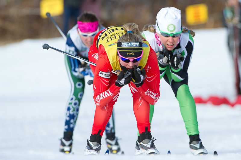 Jessie Diggins heads toward the finish line ahead of Ida Sargent, right, and Sophie Caldwell during a women's sprint semifinal Sunday at Black Mountain in Rumford. Diggins went on to earn her fourth national title of the week with a second-place finish in the final.
