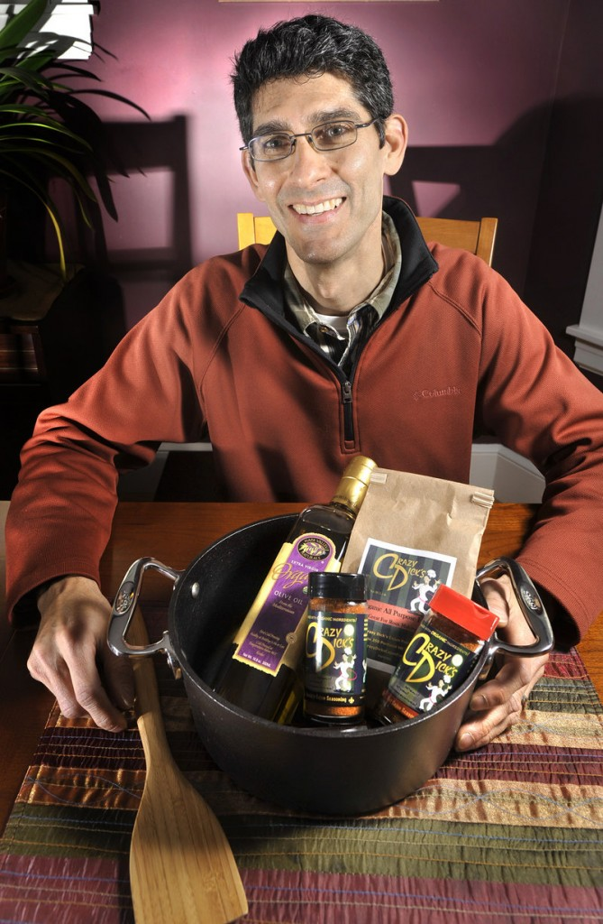 Rich Curole is making and selling an organic spice blend that reflects his Cajun heritage. In front of him is a Cajun gift set, which includes the two Crazy Dick's spice blends, organic extra virgin olive oil, organic flour, a wooden paddle and a cast iron dutch oven. It's available online, and sells for $163.95.