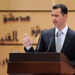 Syrian President Bashar Assad delivers a speech at Syria's Damascus University on Tuesday.