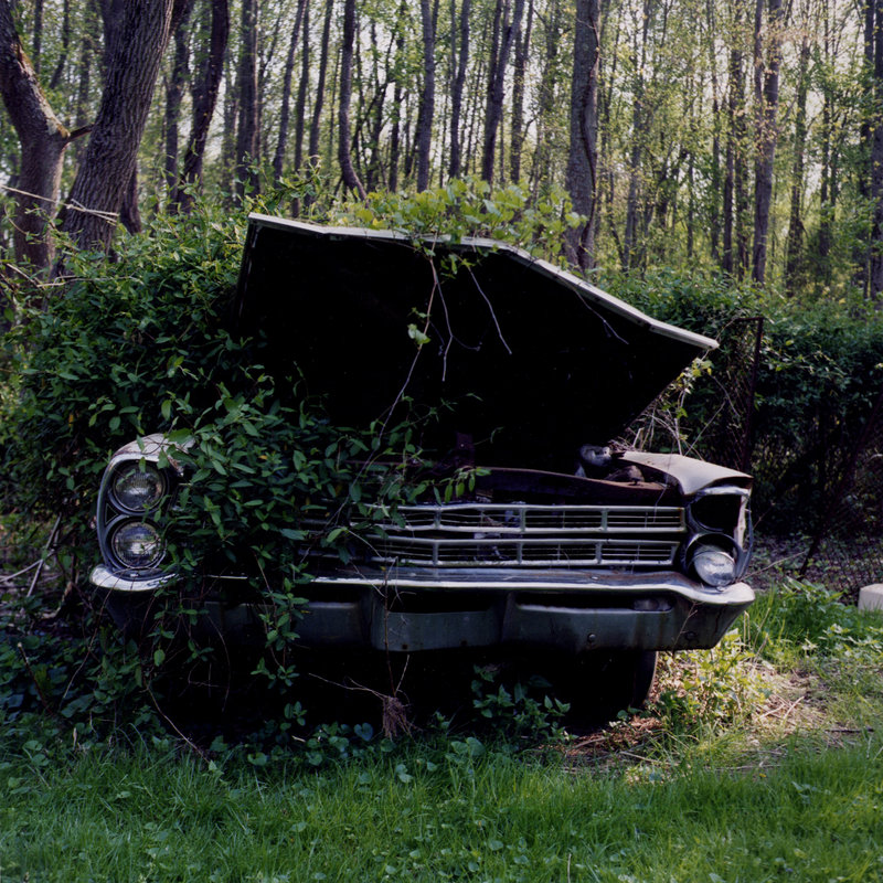 "Katie Uffelman's photograph of an abandoned car, now on display ""Drawn and Quartered: Hidden Treasures of the Studio."""