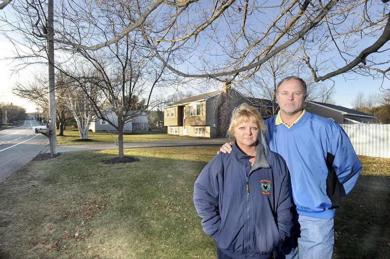 To refinance their Westbrook home, Nancy and Mike Heath had to hire a surveyor to prove that they do not live in a flood zone. If they hadn't disputed the flood zone designation, they would have had to pay $1,700 a year for federal flood insurance.