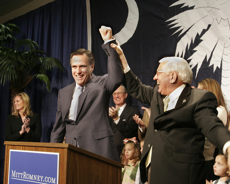 "Former South Carolina Gov. Jim Edwards introduces former Massachusetts Gov. Mitt Romney in Columbia, S.C., in February 2007. Later that year, Romney was targeted by a bogus, inflammatory Christmas card signed by ""The Romney Family'"" that was sent to GOP voters."