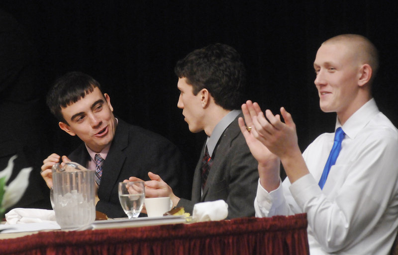 Jordan Hersom, left, of Leavitt, Louis DiTomasso, center, of Wells and Spencer Cook of Cheverus share the head table at the Fitzpatrick Trophy banquet Sunday at the Holiday Inn by the Bay in Portland.