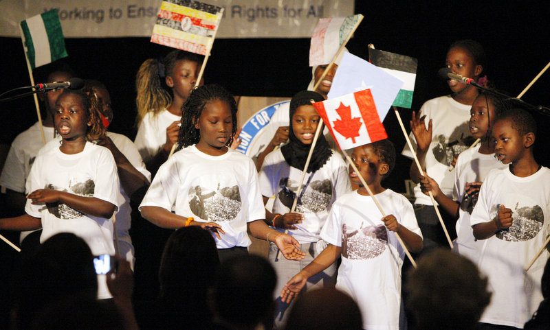 """A youth group put together by the Portland Housing Authority performs a song called """"Freedom Flag"""" on Monday at the start of the 31st annual Martin Luther King Jr. Breakfast Celebration. About 600 people attended the event at the Holiday Inn by the Bay in Portland."""