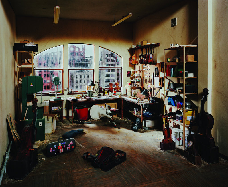 """Violin Repair Shop,"" a photograph by Lori Nix from her exhibition ""The City,"" on view through March 24 at the UMaine Museum of Art in Bangor."