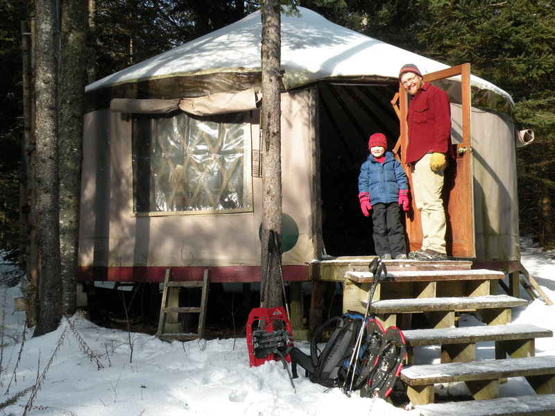 Glen Widmer and his son, Isaac, stand outside the Goose Ridge Yurt in Montville. It offers overnight stays in the wilderness without needing to travel to the deep woods.