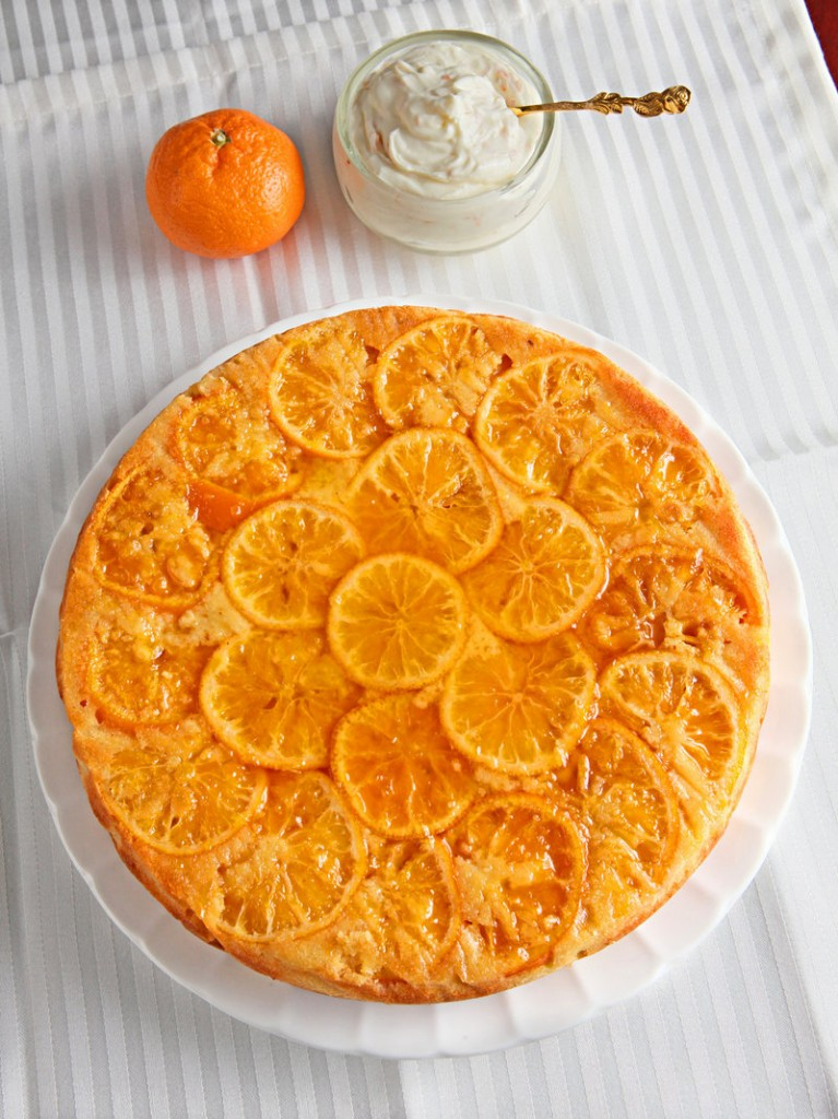 Clementine slices cook on the bottom of this clementine cake, but the finished product is then inverted, showing off the candied citrus, and slices are topped with a dollop of cheesecake cream.