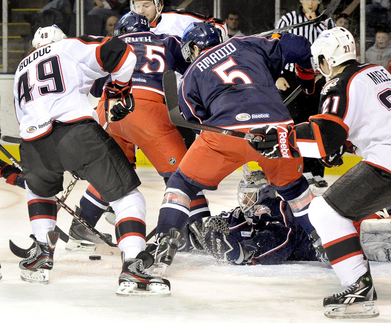 Springfield Falcons goalie Manny Legace dives for a loose puck during a 5-3 loss to the Portland Pirates at the Cumberland County Civic Center.