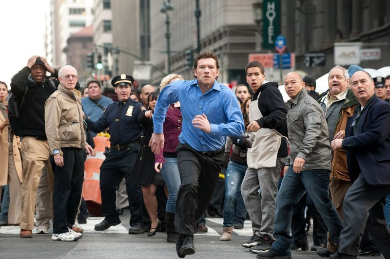 "Sam Worthington on the run in ""Man on a Ledge."""