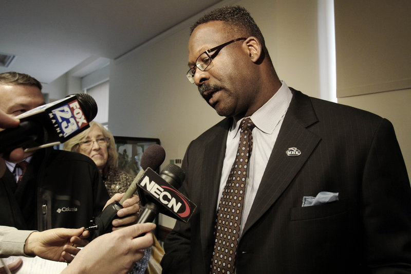 Former New England Patriots star Andre Tippett answers questions after a news conference at the State House in Augusta on Wednesday. Tippett gave his support to legislation to help schools better manage head injuries suffered by athletes.