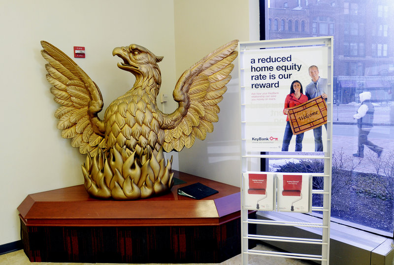 A fiberglass replica of the lost wooden phoenix is seen at Key Bank at Monument Square in Portland Thursday. Historians and others want to know what happened to the original, carved for a bank rebuilt after the city's Great Fire on July 4, 1866.