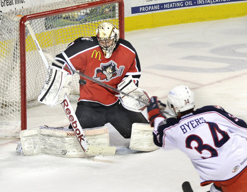 Pirates goalie Justin Pogge makes a save on a shot by Springfield's Dane Byers during Portland's 3-2 loss Friday night at the Cumberland County Civic Center.