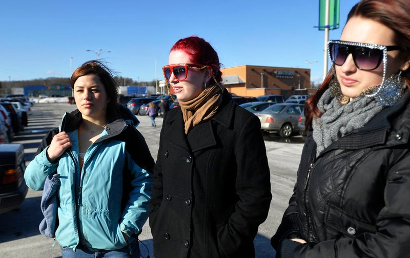 From left, Simi Russell, 18, Dessirrea Meyer, 16, and Amanda VanBrocklin, 17, all of Portland, talk about the proposed new requirements for young drivers to get their licenses while at the Maine Mall on Sunday.