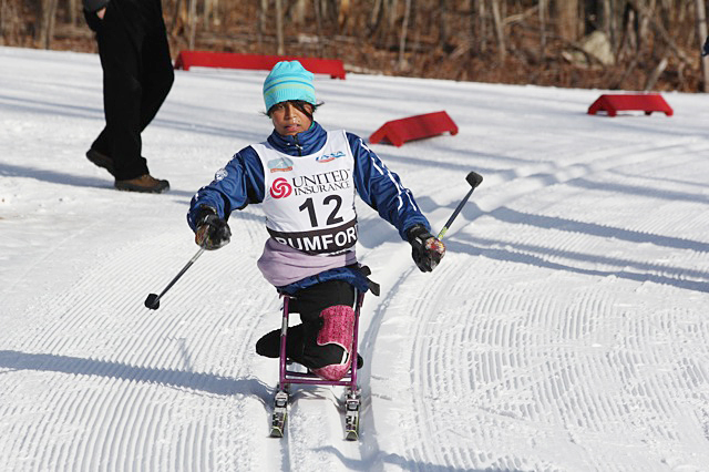 Christina Kouros, 16, of Cape Elizabeth negotiates a turn during the U.S. Cross Country Championships adaptive sit-ski sprint competition today at Black Mountain in Rumford. Kouros won a silver medal and will race again Thursday and Saturday.