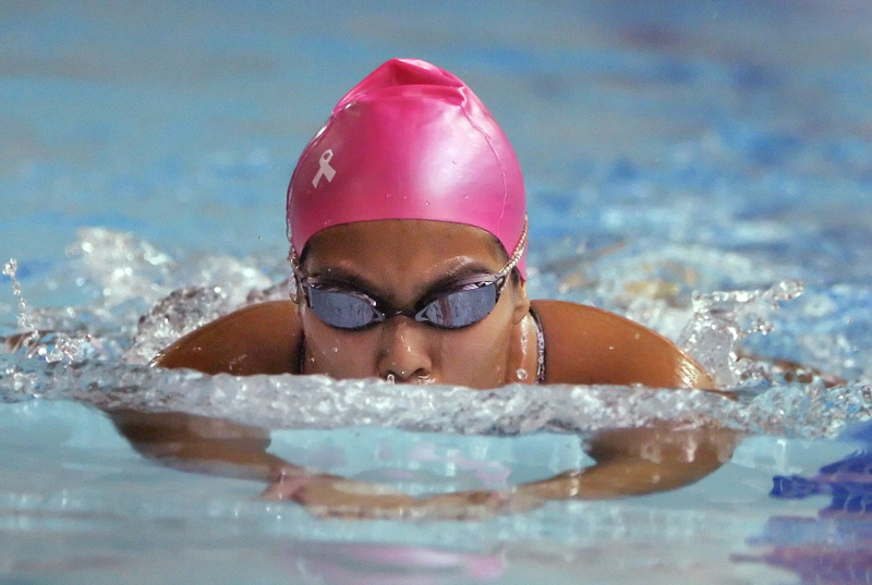 Blanca Monsen of Gorham wins the 200-yard individual medley Wednesday night with a time of 2:44.99 during a meet with Greely in Cumberland. Swimmers from several teams are wearing pink caps to raise awareness of breast cancer.
