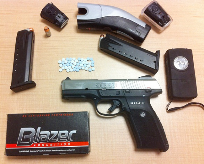 Police say items seized in the raid included this .40 caliber pistol.