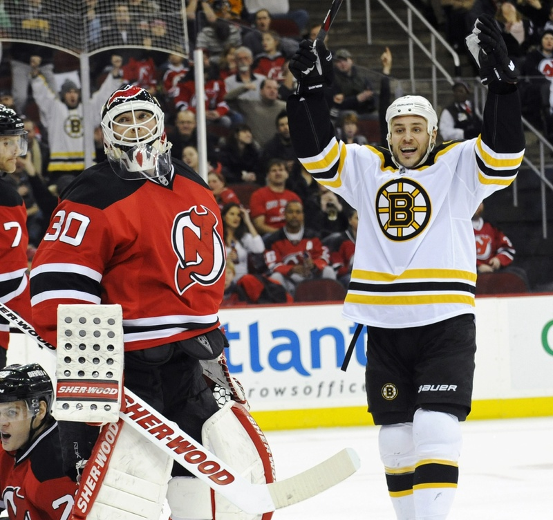 Gregory Campbell celebrates his first-period goal against Devils goaltender Martin Brodeur Wednesday night in Newark, N.J. Campbell's goal started a string of six straight goals for the Bruins, who crushed the Devils, 6-1.
