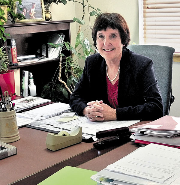 In this 2012 photo, Kennebec Valley Community College President Barbara Woodlee sits in her office at the former Teague Center in Fairfield.