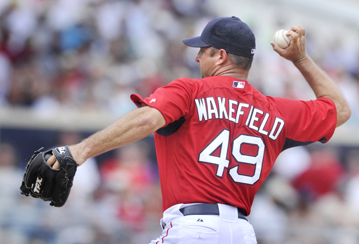 In this March 29, 2011, photo, Red Sox pitcher Tim Wakefield delivers a knuckle ball during an outing against the Tampa Bay Rays in the final home exhibition game of spring training.
