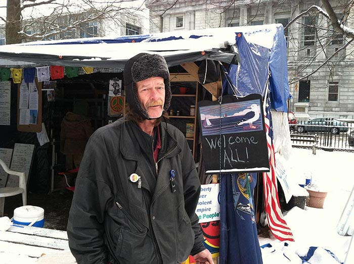 Harry Brown, one of the Occupy Maine demonstrators who has been camping out in Lincoln Park to protest economic inequities, expresses disappointment today in a judge's decision that the demonstrators' extended use of the park interferes with others' ability to use it.