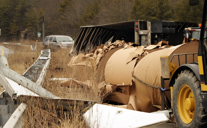 The tractor-trailer was traveling from New Brunswick, Canada, and carrying large rolls of paper.