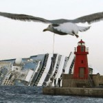 Seagulls fly in front of the grounded cruise ship Costa Concordia off the Tuscan island of Giglio, Italy, on Monday.