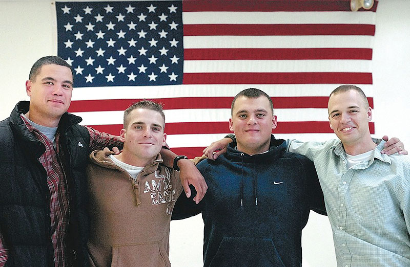 This photo from 2006 shows U.S. Marines and Madison High School alumni Isaah Finney, Kurt Fegan, Jeff Hayden and Adam Rich, left to right, who served together in Iraq and Afghanistan.