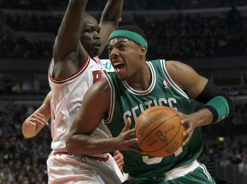 Celtics forward Paul Pierce drives past Bulls forward Luol Deng during the first half of Thursday's game in Chicago.