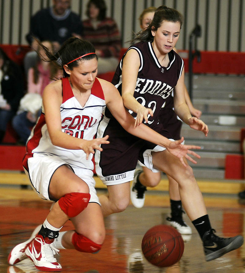 HIT THE DECK: Cony High School's Amelia Diplock, left, and Edward Little's Kelly Philbrook scramble for the ball during the Kennebec Valley Athletic Conference Class A championship game Monday in Augusta. Cony won 58-49.