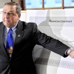 Gov. Paul LePage gestures at a graph during a news conference in December to announce proposed cuts to the MaineCare system. The graph shows the increasing number of residents who rely on MaineCare. The governor made clear in a news conference Monday that his proposal isn't just about money, but about policy too.