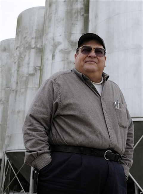 Rice farmer Ray Stoesser stands outside his rice elevator on Tuesday in Dayton, Texas.