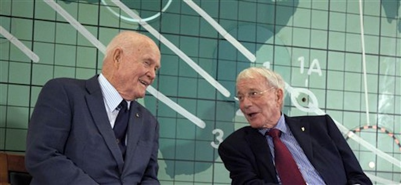 Former Sen. John Glenn, left, and Scott Carpenter, right, speak at the Kennedy Space Center, Friday, Feb. 17, 2012 in Cape Canaveral, Fla. Three days before the 50th anniversary of his historic flight, the first American to orbit the Earth addressed employees at Kennedy Space Center. (AP Photo/Michael Brown)