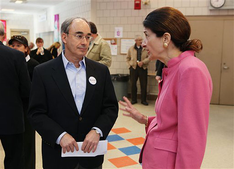 Sen. Olympia Snowe, R-Maine speaks with state Treasurer Bruce Poliquin during the Kennebec County Super Caucus in Augusta on Saturday. 2012. Snowe is facing a primary challenger for the first time in her political career. (AP Photo/Joel Page)