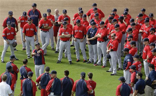 Boston Red Sox manager Bobby Valentine, center left, talks to players at the start of a baseball spring training workout on Tuesday in Fort Myers, Fla.