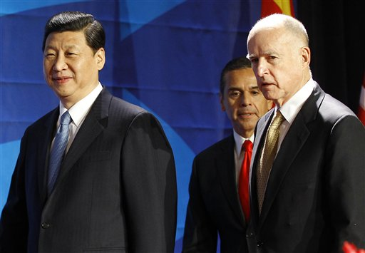 Chinese Vice President Xi Jinping, left, leaves the stage with Los Angeles Mayor Antonio Villaraigosa, center, and California Gov. Jerry Brown after speaking at the US-China Economy and Trade Cooperation Forum today in Los Angeles. Xi Jinping was the featured speaker at the forum.