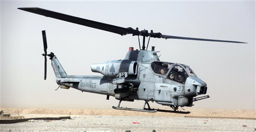 "This undated image provided by the U.S. Marines shows an AH-1W ""Cobra"" helicopter. Seven Marines were killed in a collision of two helicopters, one of them similar to this one, near Yuma, Ariz., during night training exercises on Wednesday. The other copter was a UH-1 ""Huey."" (AP Photo)"