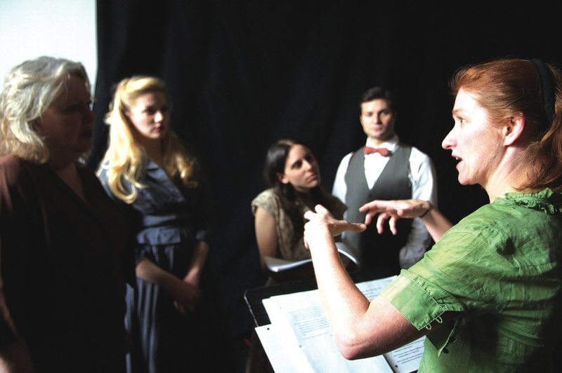 "Director Sally Wood, far right, discusses ""Hidden Tennessee"" with the cast (from left, Maureen Butler, Courtney Moors, Sarah Lord and Justin Adams). The show previews Tuesday to Thursday, and opens Friday at Portland Stage Company, 25A Forest Ave. It includes one-act plays and a short story. Tickets are $15 to $39. Call 774-0465 or visit portlandstage.org."