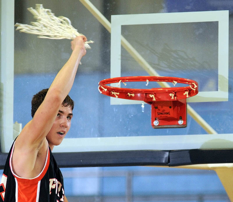 Forest Hills forward Evan Worster swings the net after cutting it down to celebrate the Tigers' victory over Hyde in the Western Class D championship game Saturday afternoon at the Augusta Civic Center. Worster scored 33 points as Forest Hills rallied for a 61-60 win.