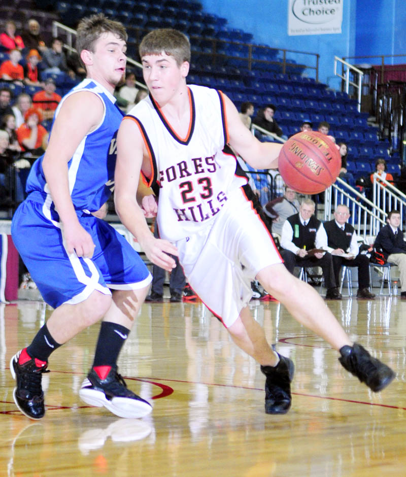 Valley forward Josh West, left, defends against Forest Hills forward Evan Worster during the Class D West tournament on Wednesday morning at the Augusta Civic Center.