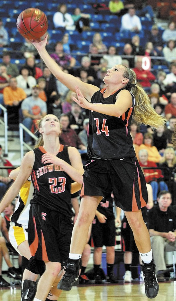 A TOUGH TASK: Skowhegan's Amanda Johnson goes up for a shot during the Indians' 56-55 win in overtime over Mt. Blue in the Eastern A regional quarterfinals Friday in Augusta. Johnson scored 27 points. richmond buckfield standish softball