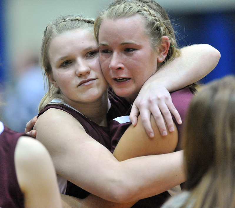 Nokomis teammates Taylor Quick, left, and Emilee Reynolds console each other after their team's loss to Presque Isle.