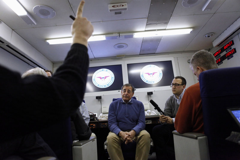 Defense Secretary Leon Panetta talks with reporters on his plane on Wednesday en route to a NATO meeting in Brussels, Belgium, where he'll discuss Afghanistan with other officials.