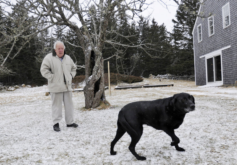John Wulp with his black Lab, Jude.
