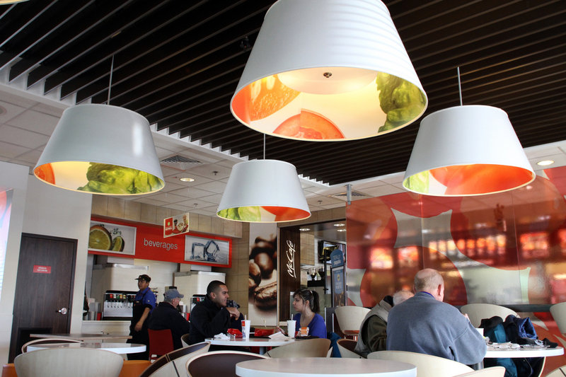 A McDonald's in Oak Brook, Ill., has been remodeled to reflect the chain's new look. On the design menu: flat-screen televisions, half-moon booths and more. Company officials are hoping a higher-end look for its stores will translate into increased sales.