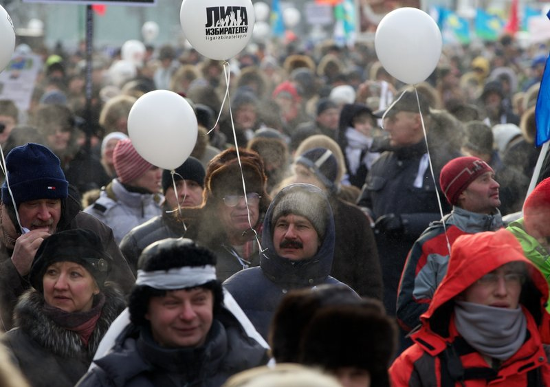 Demonstrators endure bitterly cold temperatures as they march during a massive protest against Prime Minister Vladimir Putin's rule in Moscow on Saturday.