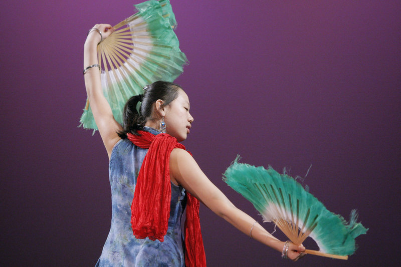 """Performances were part of the Chinese New Year celebration Saturday in Westbrook. Above, Emily Zhao dances to """"Qing Hua Ci"""" (""""Blue and White Porcelain""""). Below, Jia Chase performs the Little Calico Cats dance."""